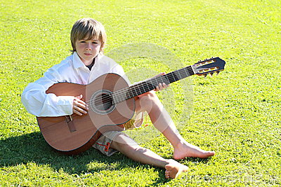 Smiling boy with a guitar