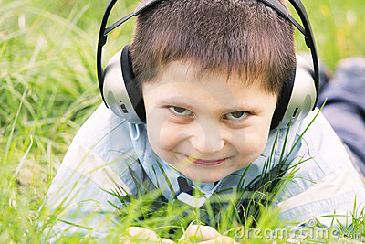 Smiling boy in headphones outdoors