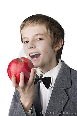 Smiling boy holding an apple