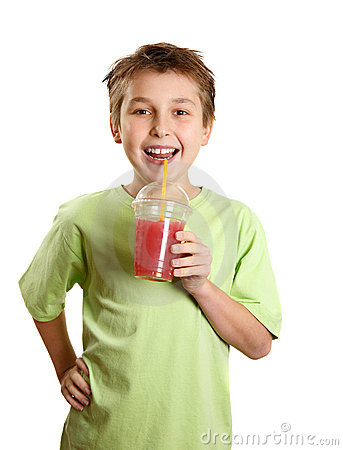 Smiling boy holding fresh fruit juice