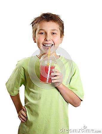 Free Smiling Boy Holding Fresh Fruit Juice Royalty Free Stock Photography - 11847177