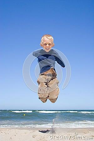 Smiling boy jumping
