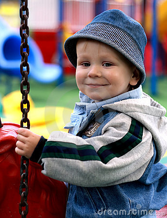Smiling boy on a merry-go-round