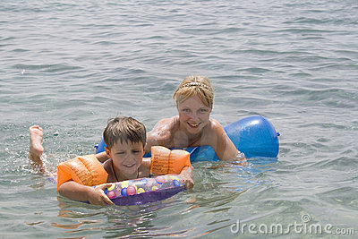 Smiling Boy and mom swiming in