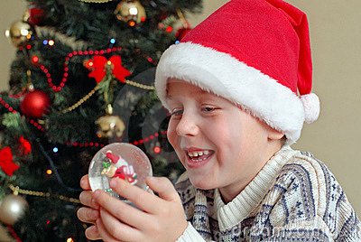 Smiling boy near christmas tree