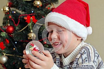 Smiling boy near christmas tree
