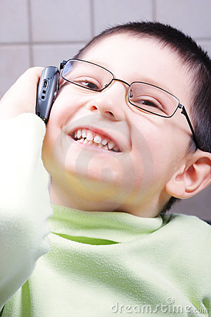 Smiling boy on phone