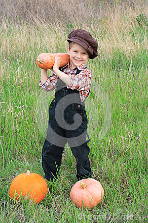 Smiling boy with pumpkins