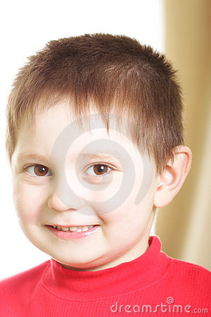 Smiling boy in red sweater