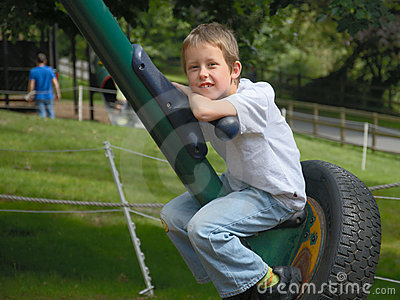 Smiling boy resting on large spin-swing