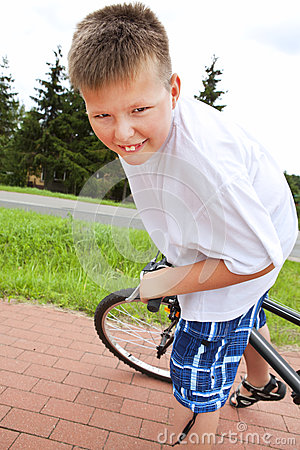 Smiling boy riding bike