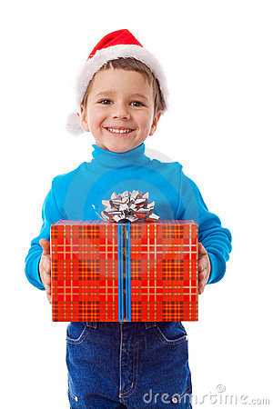 Smiling boy in Santa hat with gift box
