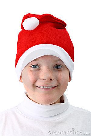 Smiling boy in Santa s red hat isolated on white