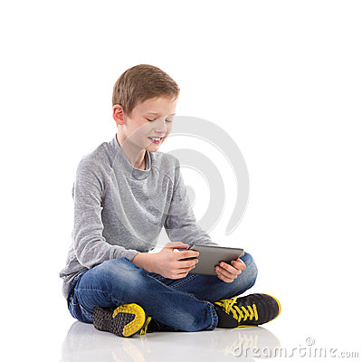 Smiling boy using a tablet.