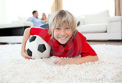 Smiling boy watching football match