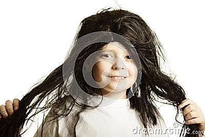 Smiling boy in wig