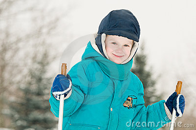 Smiling boy at winter forest