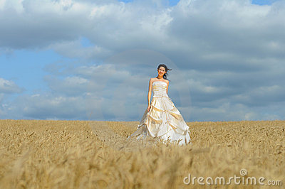 Smiling bride in a field