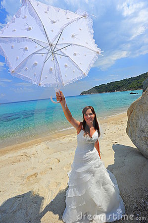 Smiling bride holding sun umbrella portrait
