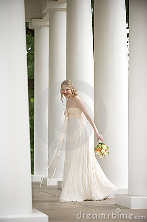 Smiling bride surrounded by columns