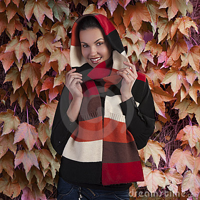 Smiling brunette in autumn scarf