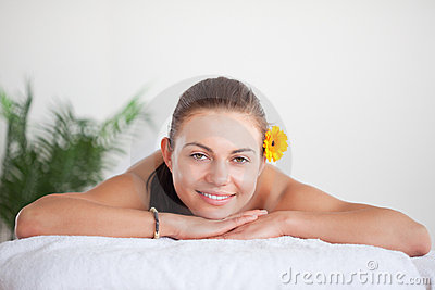 Smiling brunette with a flower on her ear