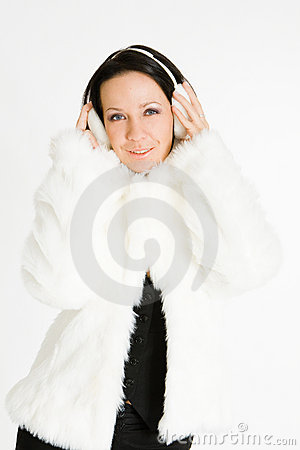 Smiling brunette in furry headphones