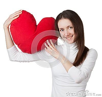 Smiling brunette girl holding red heart