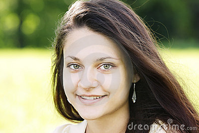 Smiling brunette with green eyes