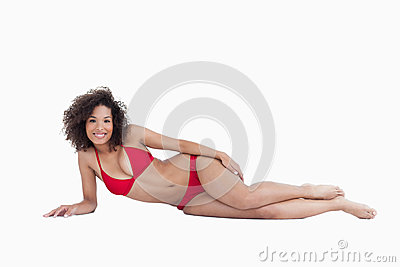 Smiling brunette lying down
