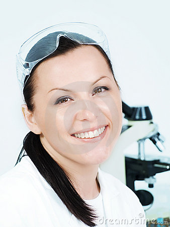 Smiling brunette researcher in laboratory