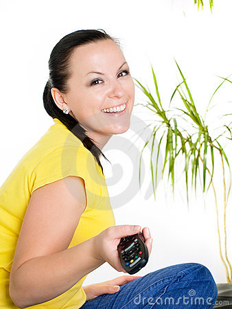 Smiling brunette woman watching tv