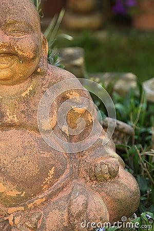 Smiling Buddha figurine