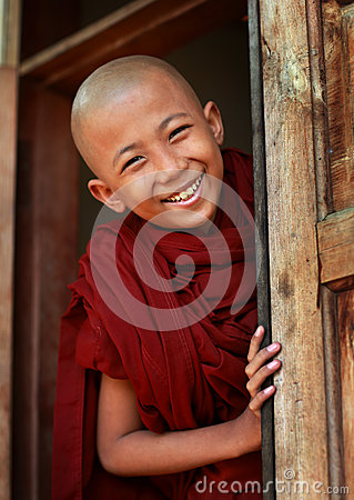 Smiling Buddhist novice Editorial Stock Photo