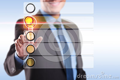 Smiling business man choosing and pushing a button