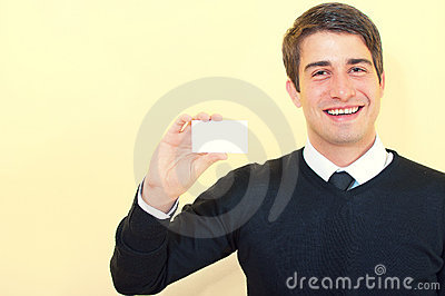Smiling business man showing a blank business card