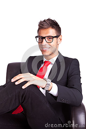 Smiling business man sitting in an armchair