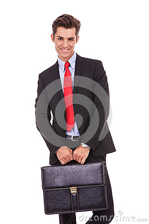 Smiling business man with a suitcase