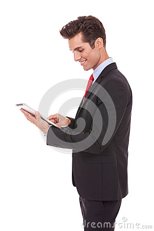 Smiling business man using his tablet computer
