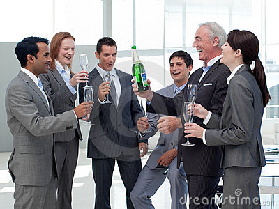 Smiling business people celebrating a success