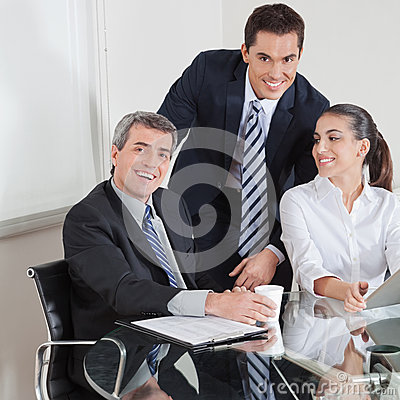 Smiling business team at table
