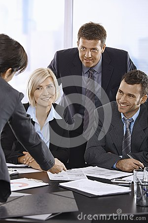 Smiling business team talking in office