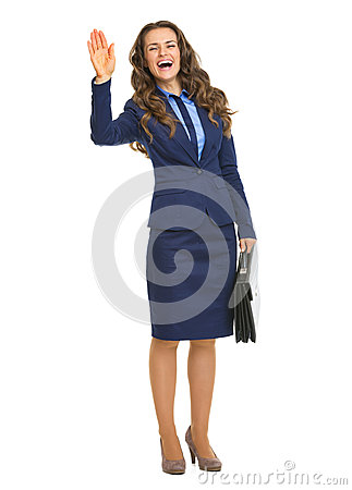 Smiling business woman with briefcase welcoming
