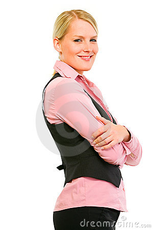 Smiling business woman with crossed arms on