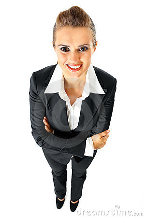 Smiling business woman with crossed arms on chest