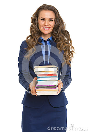 Smiling business woman giving stack of books