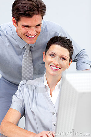 Smiling business woman and her colleague working