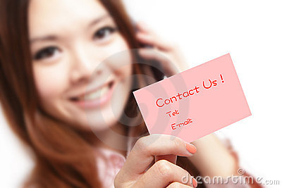 Smiling business woman holding a card (Contact Us)