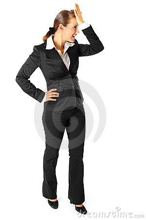Smiling business woman holding hand at forehead