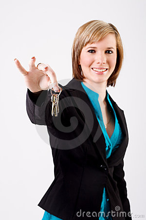 Smiling business woman holding keys